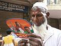 Voter reads an election pamphlet - Flickr - Al Jazeera English.jpg