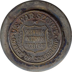 """Office of Censorship - Employee pin of World War II US War Service, Office of Censorship.  The words on the shield in the center read Silentium Victoriam Accelerat (Latin: """"Silence Speeds Victory,"""" the motto of the Office)"""