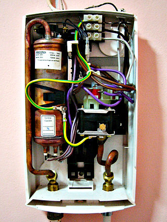 Water heating - The inside of a hydraulically operated two-stage tankless heater, heated by 3-phase electric power. The copper tank contains heating elements with 18kW maximum power.