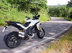 White Ducati Multistrada 1200s by road.jpg