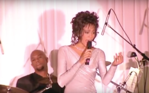 Houston performing at a state dinner in the White House honoring then South African president Nelson Mandela in 1994. Whitney Houston performs at state dinner for Mandela in 1994 2.png