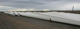 Wind-turbine aerodynamics - Wind-turbine blades awaiting installation in laydown yard.