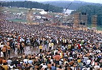Millions participate in the Woodstock Festival of 1969.