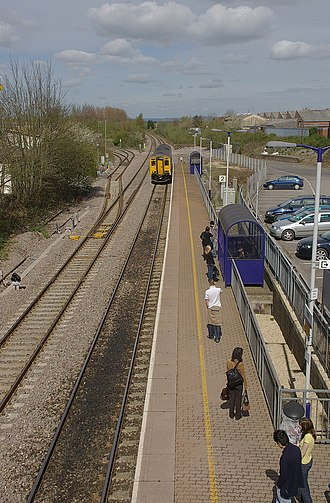 Yate railway station - 150279 arrives at the Bristol side of the station.