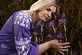 День Вишиванки. Молода україночка у вишитій синій сукні серед квітів 16.jpg