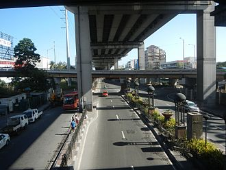 South Luzon Expressway - Pres. Sergio Osmeña Sr. Highway segment of SLEx in Magallanes, Makati just south of Magallanes Interchange. On its left side is the Balintawak-Araneta-Sucat transmission line of National Grid Corporation of the Philippines.