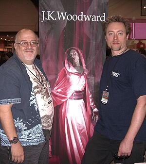 Fallen Angel (comics) - Peter David and J.K. Woodward in front of Woodward's illustration of Lee at the New York Comic Con, October 10, 2010.