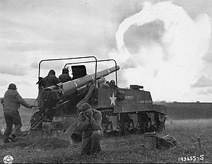 M12 Gun Motor Carriage - M12 firing across the Moselle River in France, 1944.