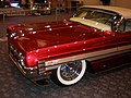 1961 red Oldsmobile Starfire side 1.JPG