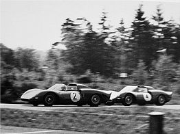 Parkes at 1965 1000km Nürburgring in front of Graham Hill, both in Ferraris
