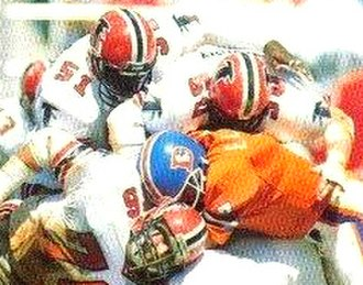 Denver Broncos - Elway (center) getting tackled by the Atlanta Falcons in 1985.