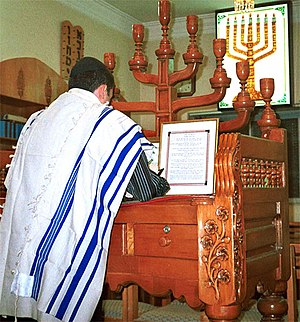 An Iranian Jew prays in a synagogue in Shiraz,...