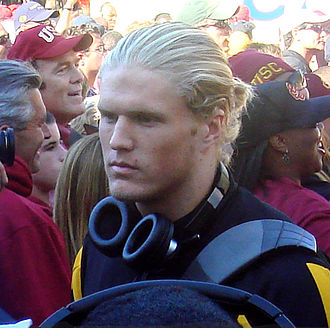 Clay Matthews III - A college-age picture of Clay Matthews III, standing in a crowd of USC fans