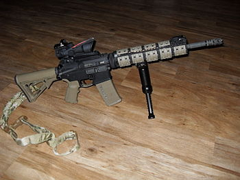 English: A custom built AR-15 rifle with an AC...