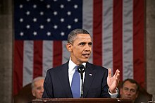 Obama speaks in front of Joe Biden and John Boehner.