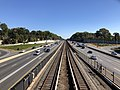2018-10-23 12 25 51 View east along Interstate 66 and the Orange Line of the Washington Metro from the overpass for Virginia State Route 243 (Nutley Street) on the border of Oakton and Merrifield in Fairfax County, Virginia.jpg
