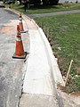 2021-07-14 12 49 13 A section of curb replaced within the prior 24 hours along Tranquility Court in the Franklin Farm section of Oak Hill, Fairfax County, Virginia.jpg