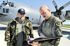 339th Flight Test Squadron - Eddie Minter, C-130 functional test work lead, mets with MSgt. Tony Valente, flight engineer to look over work records before a testflight of an MC-130E