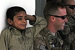 82nd Airborne Division medic interacts with Afghan child DVIDS483314.jpg
