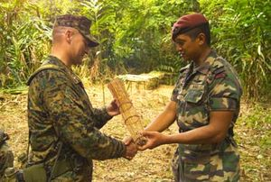 Royal Ranger Regiment - As a gesture of friendship, a Malaysian 8th Royal Ranger Regiment officer presents a hand-made fish trap to US Marines Lt. Col. T. Armstrong, commanding officer, Landing Force, exercise Cooperation Afloat Readiness And Training (LF CARAT).