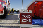 """A """"Cold Zone"""" sign sits by decontamination tents set up by emergency responders during an operational readiness exercise at Eielson Air Force Base, Alaska, March 11, 2011 110311-F-HE010-001.jpg"""