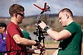 A U.S. Marine helps a British Royal Marine assemble his bow before archery practice for the 2012 Marine Corps Trials at Marine Corps Base Camp Pendleton, Calif., Feb. 14, 2012 120214-M-II268-017.jpg