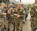 A Ukrainian Soldier reloads his magazine.jpg
