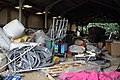 A barn with abandoned waste and equipment at Hatfield Broad Oak Essex England.JPG