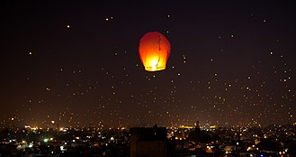 Makar Sankranti - A night lit up on Makar Sankranti Uttarayana Festival with Kites and Lights.