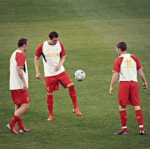Danny Wilson (footballer, born 1991) - Wilson warming up, along with compatriot Charlie Adam and Jon Flanagan.