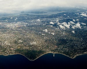 Fauntleroy, Seattle - Aerial view of Fauntleroy, looking east towards Lake Washington. The forested point in the foreground is Lincoln Park. Fauntleroy Park can be seen slightly above that and to the right
