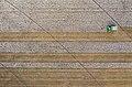 Aerial view of cotton harvester making horizontal stripe in Batesville, Texas field.jpg
