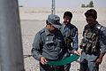 Afghan police build swing set for boys school 120517-M-DM345-004.jpg