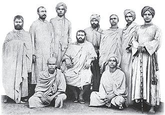 Disciples of Ramakrishna - Alambazar Math, 1896 (farewell to Swami Abhedananda leaving for the US) (from left) standing: Swami Adbhutananda, Swami Yogananda, Swami Abhedananda, Swami Trigunatitananda, Swami Turiyananda, Swami Nirmalananda, and Swami Niranjanananda(The Senior); sitting: Swami Subodhananda, Brahmananda (on chair), and Akhandananda