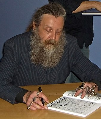 Moore signing an autograph, 2006 Alan Moore.jpg