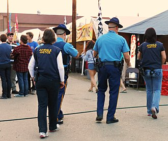 Alaska Division of Juvenile Justice - Two female DJJ officers, accompanied by two uniformed Alaska State Troopers, as they patrol the fairgrounds during the 2012 Tanana Valley State Fair.