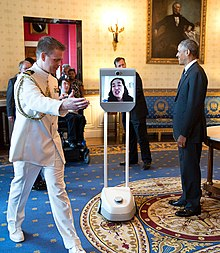 Alice Wong participated at the 25th anniversary of the Americans With Disabilities Act via robot in the White House