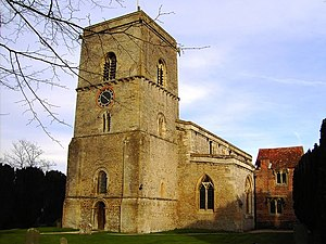 All Saints' Church, Sutton Courtenay - The church from the southwest, showing the west tower and one-handed clock dial