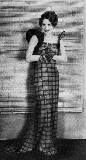 Gladys Parker - Annette Hanshaw models a dress designed by Parker, 1934