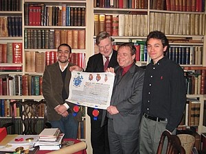 Ari Norman - Ari Norman with sons Lee (L) and Adam (R) being presented with the Patent for his Family Coat of Arms by Thomas Woodcock, Norroy and Ulster King of Arms at The College of Arms