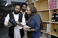 AusAID's Kate Elliott with Dr Ajab Noor and Chief pharmastist Mr. Kikmat Ullah at AHDS, Tarin Kowt, Uruzgan Province, Afghanistan, 2009. Photo- Lorrie Graham (10673379003).jpg