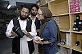 AusAID's Kate Elliott with Dr Ajab Noor and Chief pharmastist Mr. Kikmat Ullah at AHDS, Tarin Kowt, Uruzgan Province, Afghanistan, 2009. Photo- Lorrie Graham (10673379003).jpg