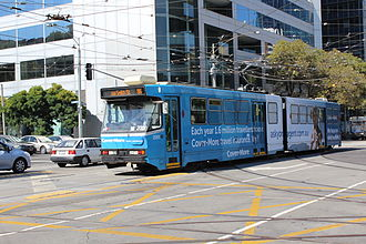 B-class Melbourne tram - B1 2001 on route 86 on Nicholson Street in advertising livery in April 2013
