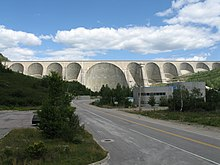 A large concrete dam with multiple arches