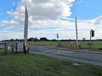 London Southend Airport - Temporary closing of barriers across Eastwoodbury Lane was required for large aircraft movements until the road was diverted to enable the construction of the runway extension in August 2012