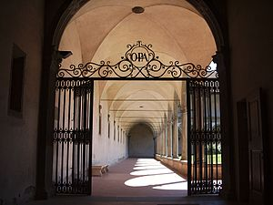 "Santa Croce, Florence - A gate in the gardens with the letters ""OPA"" for ora pro animis (""pray for souls"")"