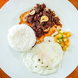 Beef tapa with steamed rice and sliced tomato and cucumber.jpg