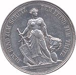 Standing Helvetia holding sword and shield, bear behind. Legend along edge.