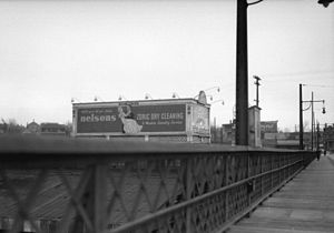 Pattison Outdoor Advertising - Lighted Ruddy-Duker Ltd. billboard advertising Nelsons Zoric Dry Cleaning and Modern Laundry Service on the west side of the Granville Street Bridge, Vancouver, 1932