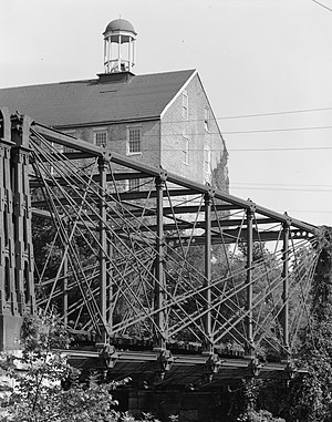Bollman Truss Railroad Bridge - Bollman Bridge with Savage Mill tower in background, 1970